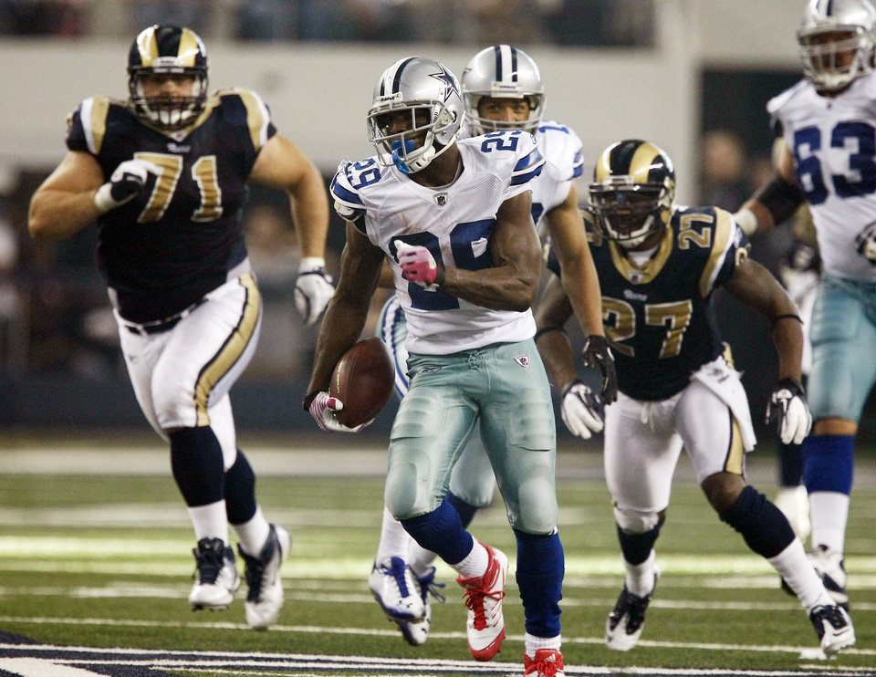 Photo - Dallas Cowboys running back DeMarco Murray (29) runs  from St. Louis Rams defensive tackle Gary Gibson (71) and free safety Quintin Mikell (27) for a first down during the second half  of an NFL football game Sunday, Oct. 23, 2011, in Arlington, Texas. (AP Photo/Waco Tribune Herald, Jose Yau) ORG XMIT: TXWAC110