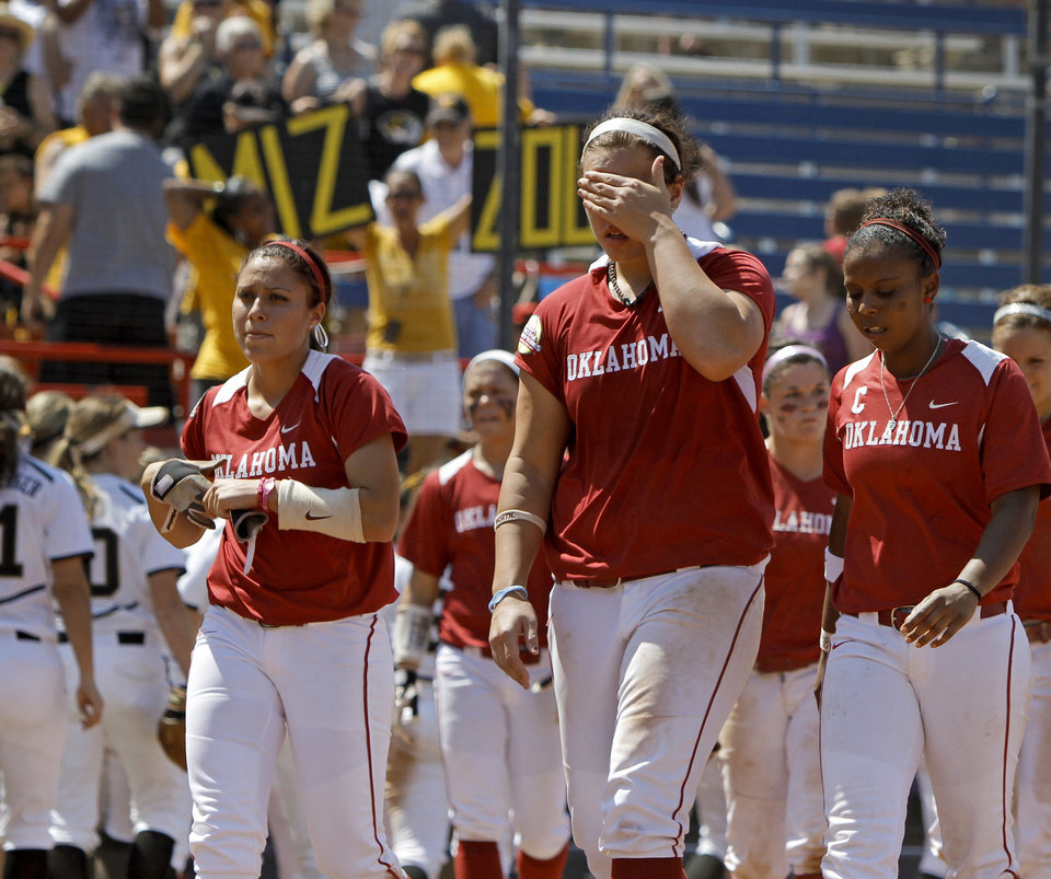 Oklahoma's Destinee Martinez, left, Keilani Ricketts, and Oklahoma's Chana'e Jones walk off the field after losing a Women's College World Series softball game between the University Oklahoma and Missouri at ASA Hall of Fame Stadium in Oklahoma City, Saturday, June 4, 2011. Missouri won, 4-1. Photo by Bryan Terry, The Oklahoman ORG XMIT: KOD
