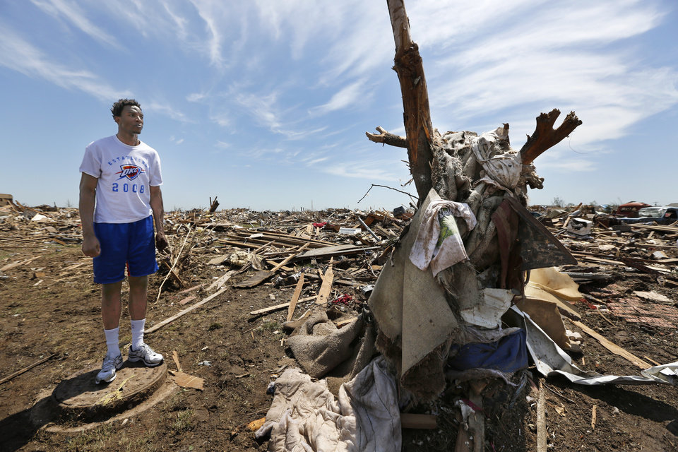 Oklahoma City Thunder's Hasheem Thabeet looks at damage near SW 146th street in Oklahoma City, Wednesday May 22, 2013. Members of the Oklahoma City Thunder and family members took a tour of the area hit by a tornado on Monday afternoon. Photo By Steve Gooch, The Oklahoman