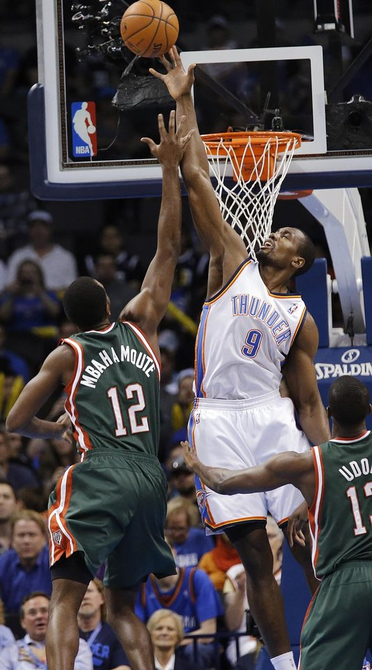 Oklahoma City's Serge Ibaka (9) blocks a shot by Milwaukee 's Luc Richard Mbah a Moute (12) during the season finally NBA basketball game between the Oklahoma City Thunder and the Milwaukee Bucks at Chesapeake Energy Arena on Wednesday, April 17, 2013, in Oklahoma City, Okla.   Photo by Chris Landsberger, The Oklahoman