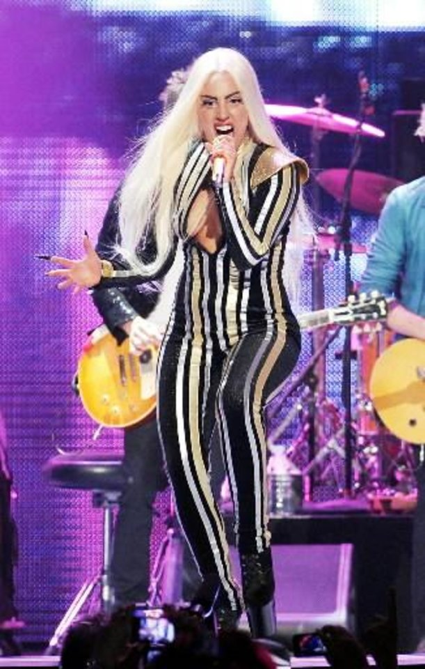 his Dec. 15, 2012 file photo shows singer Lady Gaga performing at the Prudential Center in Newark, N.J. Lady Gaga\'s tour confirmed Tuesday, Feb. 12, 2013, that the singer has postponed performances in Chicago, Detroit and Canada from Feb. 13 - Feb. 17, due to a severe inflammation of joints. (Photo by Evan Agostini/Invision/AP, file)