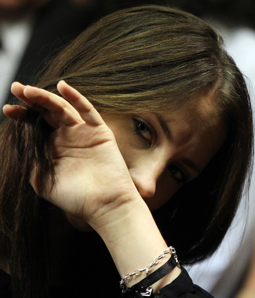 Olympic athlete Oscar Pistorius\' sister Aimee Pistorius looks on during his bail hearing at the magistrate court in Pretoria, South Africa, Friday, Feb. 22, 2013. Pistorius was granted bail in the Pretoria Magistrate\'s Court on Friday. (AP Photo/Themba Hadebe)