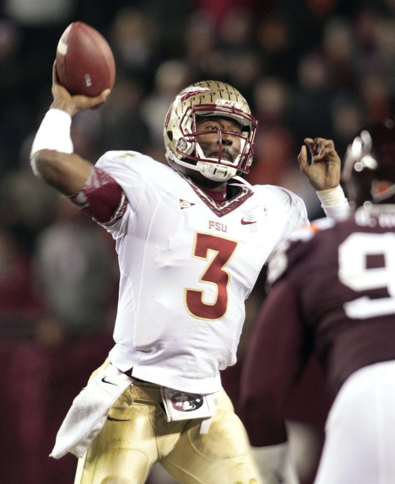 Photo -   Florida State quarterback EJ Manuel passes during the first half of an NCAA college football game against Virginia Tech in Blacksburg, Va., Thursday, Nov. 8, 2012. (AP Photo/Steve Helber)