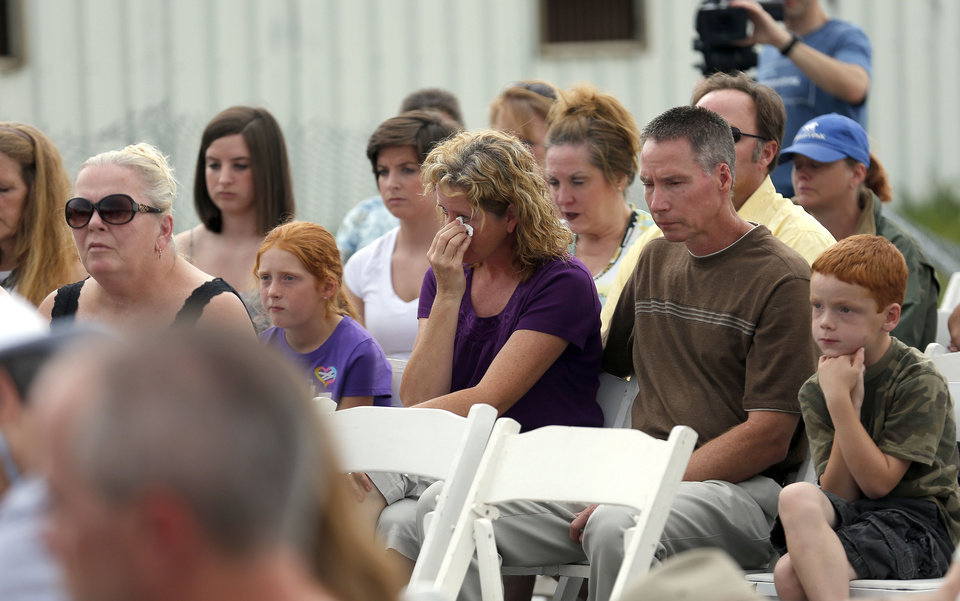 Photo - People attend a memorial on Saturday at the Orr Family Farm, 14400 S Western, to honor animals who died in the May tornadoes.   SARAH PHIPPS - SARAH PHIPPS