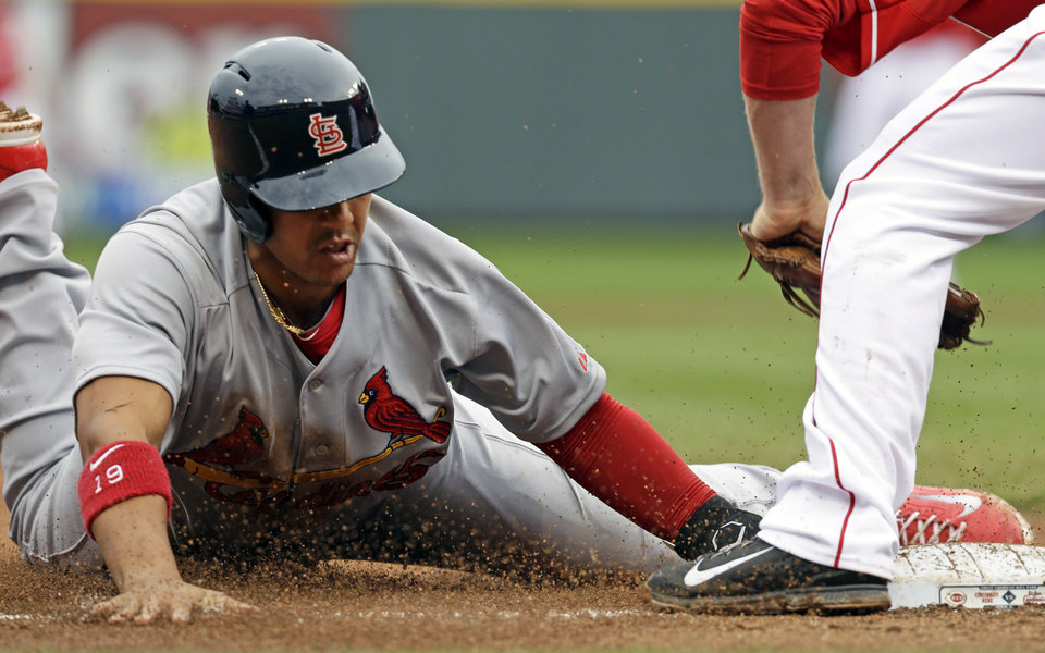 St. Louis Cardinals' Jon Jay (19) is tagged out by Cincinnati Reds third baseman Todd Frazier while trying to steal third base in the fourth inning of a baseball game on Thursday, April 3, 2014, in Cincinnati. (AP Photo/Al Behrman)
