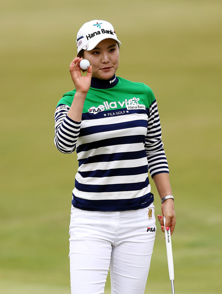 Photo - South Korea's So Yeon Ryu holds up her ball after putting on the 18th green during the third day of the Women's British Open golf championship at the Royal Birkdale Golf Club, Southport, England, Saturday July 12, 2014. (AP Photo/Scott Heppell)