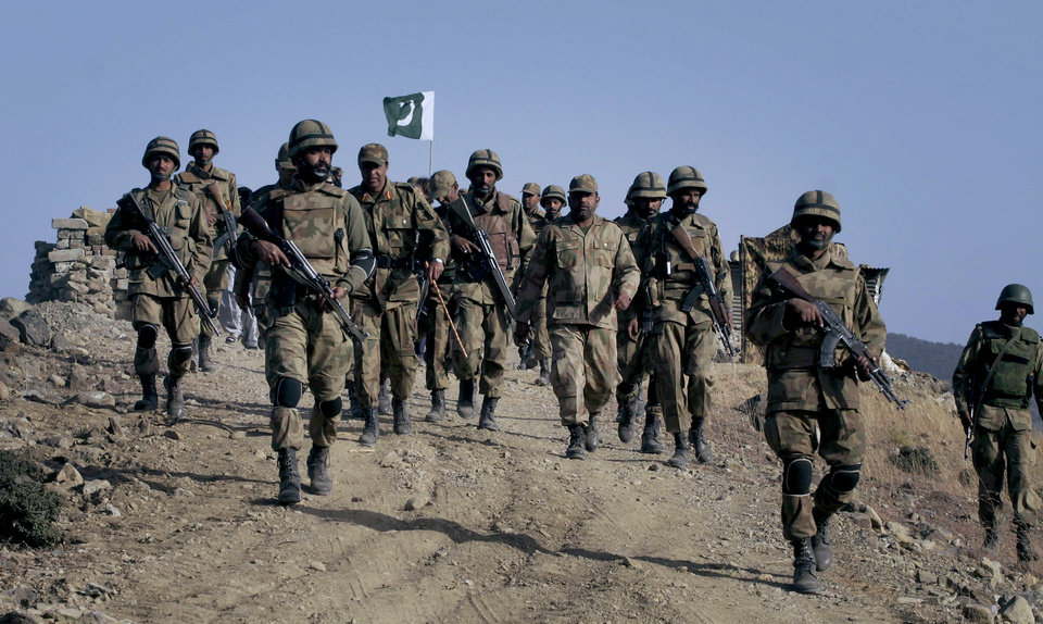Photo - FILE - In this Tuesday, Nov. 17, 2009 file photo, Pakistani troops walk on a hilltop post near Ladha, a town in the Pakistani troubled tribal region of South Waziristan along the Afghan  border. The Pakistani army said it has launched a