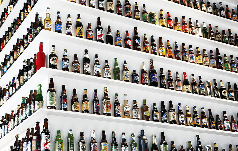 Bottles of beer line the walls of Republic Gastropub.  Photo by David McDaniel, The Oklahoman