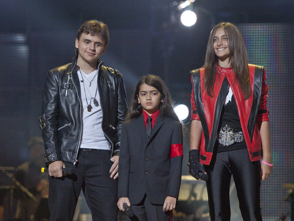 Photo -   FILE - In this Oct. 8, 2011 file photo, from left, Prince Jackson, Prince Michael II