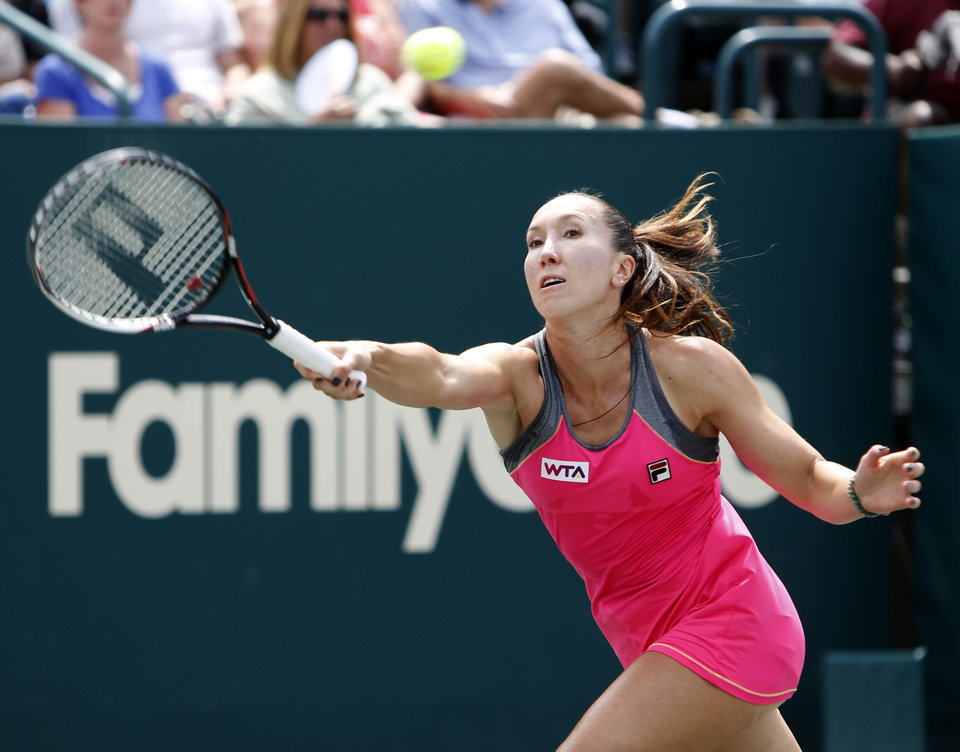 Photo - Jelena Jankovic, of Serbia, returns to Eugenie Bouchard, of Canada, during the Family Circle Cup tennis tournament in Charleston, S.C., Friday, April 4, 2014. (AP Photo/Mic Smith)