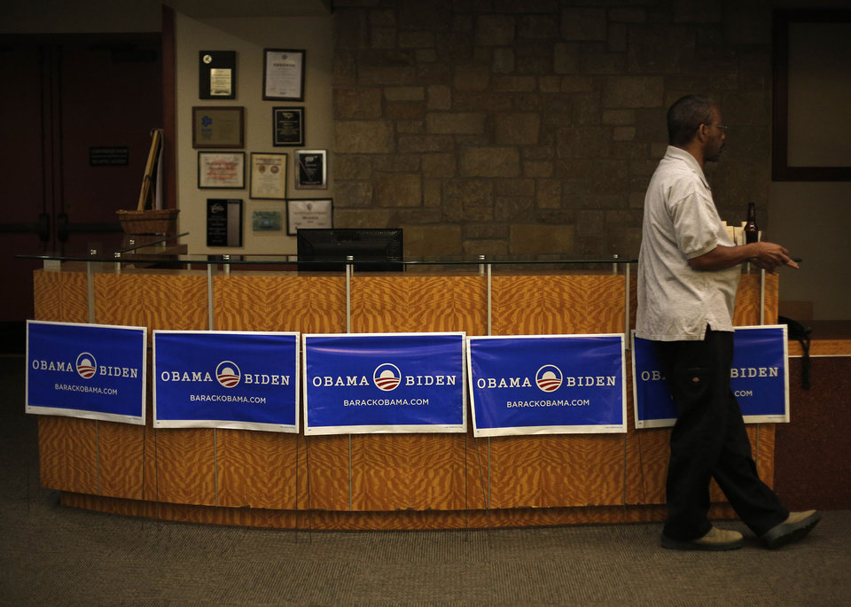 Eric Dixon, of Oklahoma City, watches a television during the Oklahoma Democratic Party watch gathering at the Reed Center in Midwest City, Tuesday, Nov. 6, 2012.  Photo by Garett Fisbeck, The Oklahoman