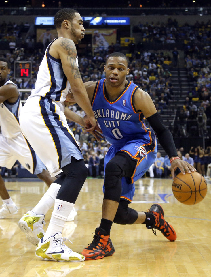 Oklahoma City's Russell Westbrook (0) tries to get around Memphis' Courtney Lee (5) during Game 6  in the first round of the NBA playoffs between the Oklahoma City Thunder and the Memphis Grizzlies at FedExForum in Memphis, Tenn., Thursday, May 1, 2014. Photo by Bryan Terry, The Oklahoman