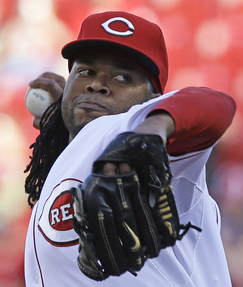 Photo - Cincinnati Reds starting pitcher Johnny Cueto throws against the Philadelphia Phillies in the first inning of a baseball game, Friday, June 6, 2014, in Cincinnati. (AP Photo/Al Behrman)
