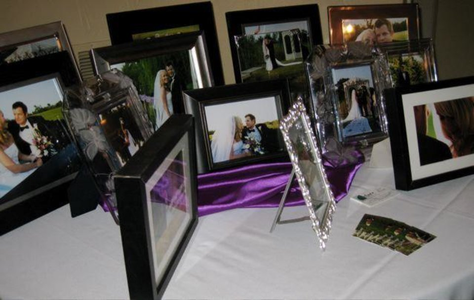 PICTURE PERFECT...Framed pictures of Angi's and Joel's September  wedding were displayed on the tables. (Photo by Helen Ford Wallace).