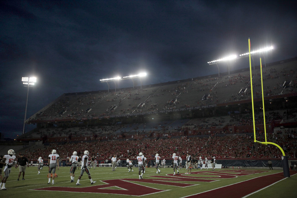 Photo - OSU warms up before the college football game between the University  of Arizona and Oklahoma State University at Arizona Stadium in Tucson, Ariz.,  Thursday, Jan. 17, 2008. Photo by Sarah Phipps, The Oklahoman