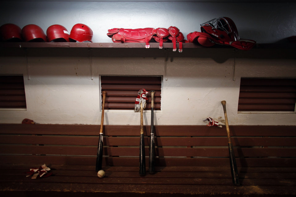 In this photo taken Dec. 29, 2012, baseball gear is scattered throughout a dugout at a local stadium in Caguas, Puerto Rico. The U.S. territory has seen the opening of new baseball academies and an expansion of its winter league teams, whose tournament this year is dedicated to Hall of Famer and Puerto Rican hero Roberto Clemente on the 40th anniversary of his death. Clemente died in a plane crash off Puerto Rico's north coast on Dec. 31, 1972 while helping deliver supplies to earthquake victims in Nicaragua. Thousands mourned his death, including Major League Baseball Commissioner Bud Selig. (AP Photo/Ricardo Arduengo)