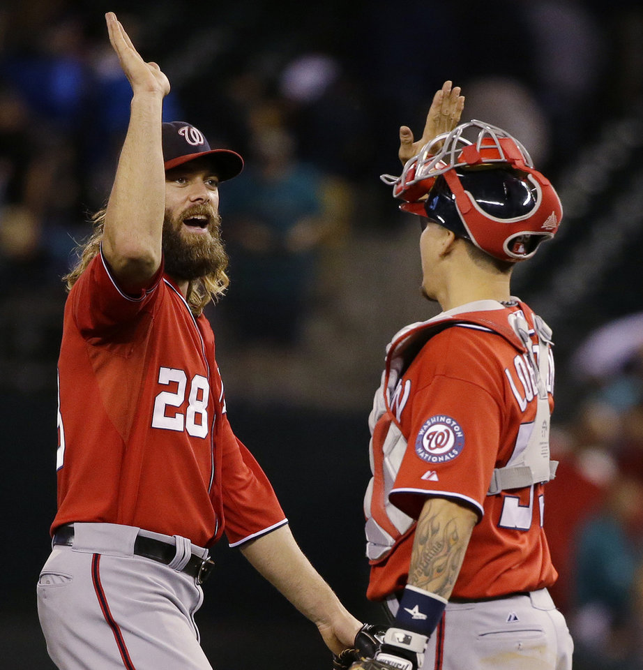 Photo - Washington Nationals right fielder Jayson Werth, left, greets catcher Jose Lobaton after the Nationals defeated the Seattle Mariners 3-1 in a baseball game, Saturday, Aug. 30, 2014, in Seattle. (AP Photo/Ted S. Warren)