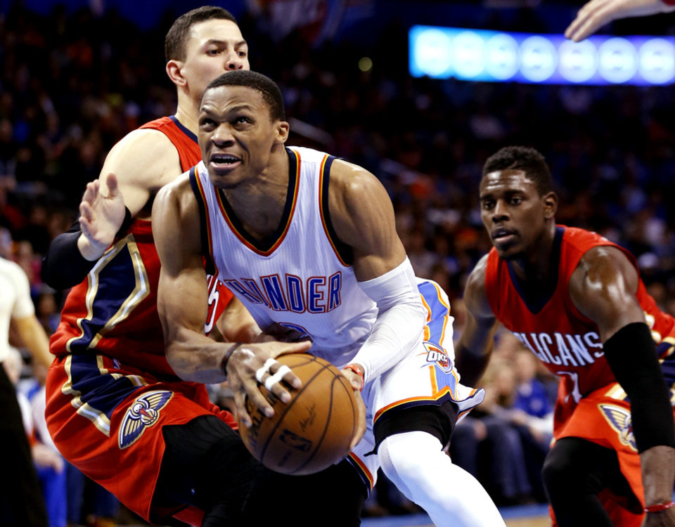 Photo - Thunder's Russell Westbrook (0) drives past Pelican's Austin Rivers (25) during the second half of an NBA basketball game between the Oklahoma City Thunder and the New Orleans Pelicans at Chesapeake Energy Arena on Dec. 21, 2014 in Oklahoma City, Okla. Photo by Steve Sisney, The Oklahoman
