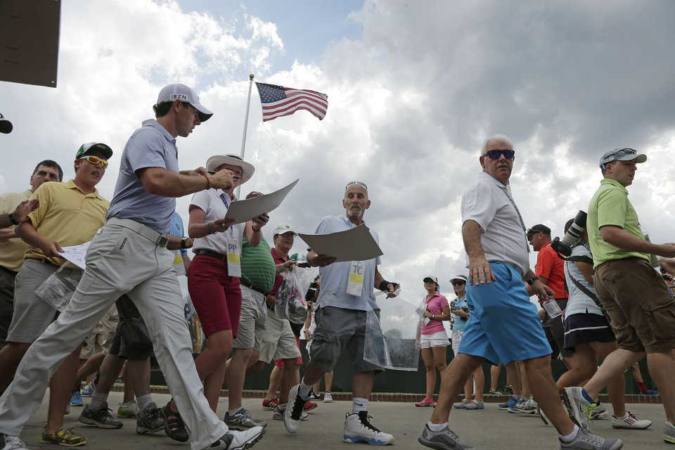 Photo - Rory McIlroy, of Northern Ireland, leaves the course after practice was suspended due to weather at the U.S. Open golf tournament in Pinehurst, N.C., Wednesday, June 11, 2014. The tournament starts Thursday. (AP Photo/Charlie Riedel)