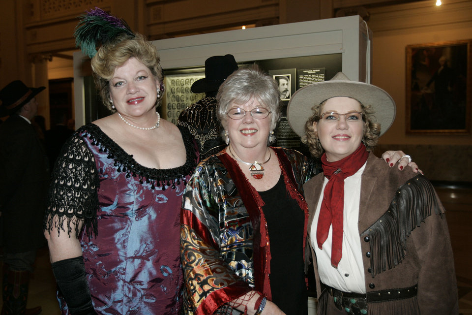 Photo - Mary Watts of Guthrie, left, Mell Thalasinos, of Guthrie, center, and Lisa Sorrell, of Guthrie, attend the Oklahoma Centennial Statehood Inaugural Ball, Saturday, Nov. 17, 2007, at the Guthrie Scottish Rite Masonic Center, in Guthrie, Okla. By Bill Waugh, The Oklahoman