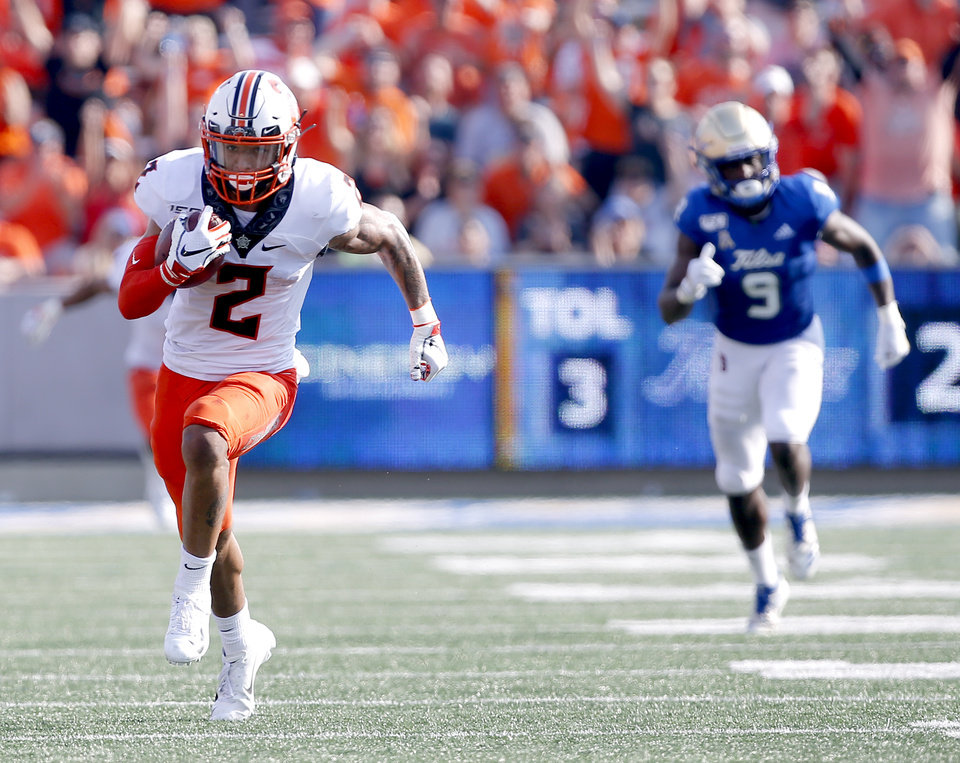 Photo - Oklahoma State's Tylan Wallace (2) runs in for a touchdown after a reception in the third quarter during a college football game between the Oklahoma State University Cowboys (OSU) and the University of Tulsa Golden Hurricane (TU) at H.A. Chapman Stadium in Tulsa, Okla., Saturday, Sept. 14, 2019. [Sarah Phipps/The Oklahoman]
