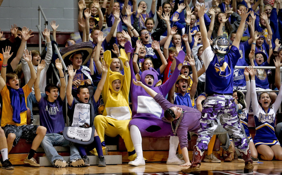 Photo - Okarche fans cheer on their Lady Warriors during the Class B girls state basketball quarterfinal game between Okarche and Burlington at Southern Nazarene University in Bethany, Okla. on Thursday, March 6, 2014.  Photo by Chris Landsberger, The Oklahoman