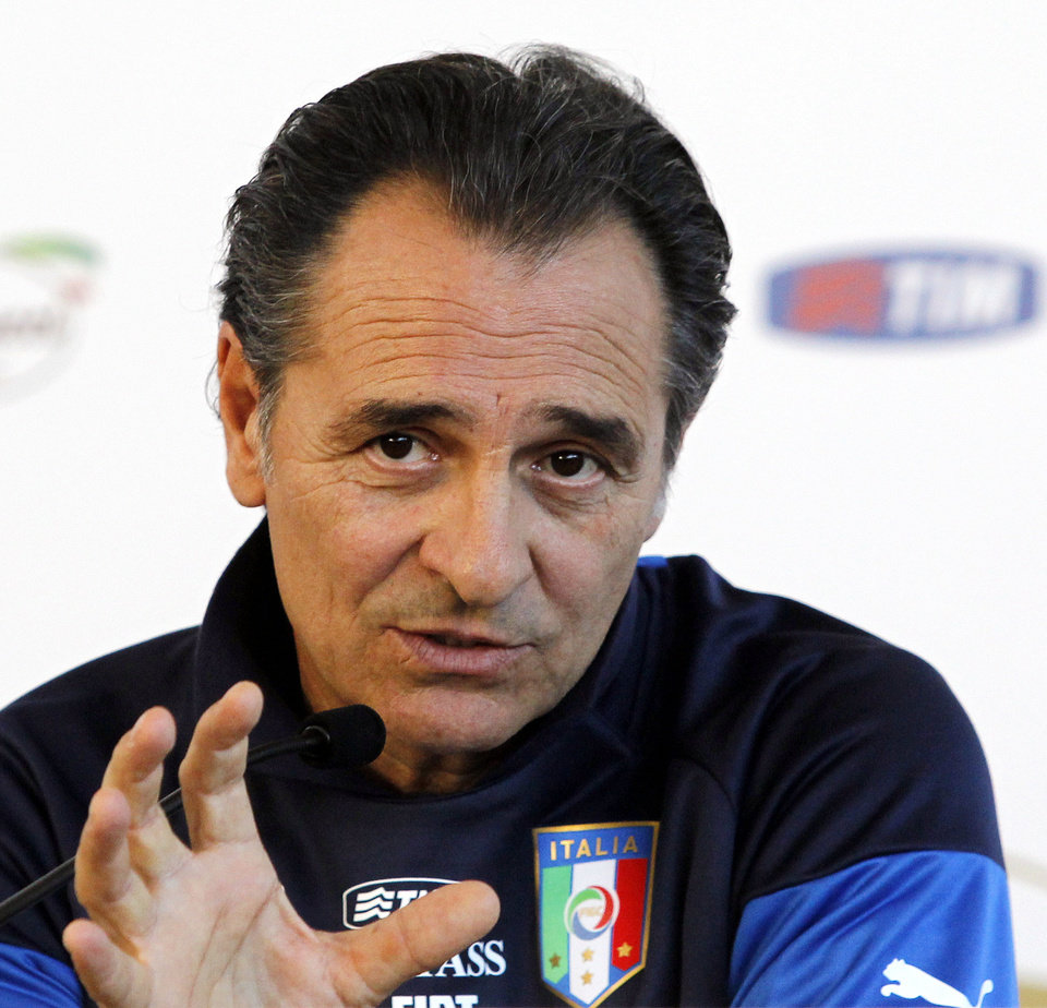 Photo - Italy coach Cesare Prandelli speaks during a press conference at the national team's Coverciano training complex in Florence, Italy, Tuesday, April 15, 2014, where 42 players were called up for World Cup fitness tests. (AP Photo/Fabrizio Giovannozzi)