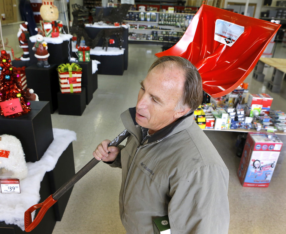 Steve Dodson, Oklahoma City, carries a  snow shovel to the check-out stand. The threat of a severe winter storm, expected to arrive in Oklahoma City on Christmas Day,  ushered a throng of customers into the Westlake Hardware Store, 1509 W Britton Road,  to purchase snow shovels, ice melt, snow scrapers and tubes filled with sand on Monday, Dec. 24, 2012, Photo by Jim Beckel, The Oklahoman
