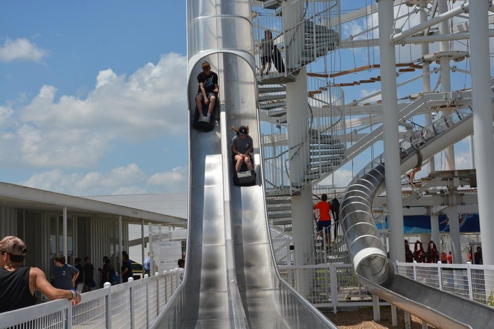 Photo - High speed slides and the SandRidge Sky Trail are two of the attractions opening for the season Saturday at Riversport Adventures in downtown OKC's Boathouse District. [Photo provided]