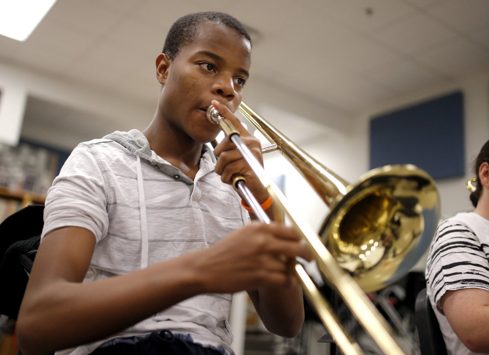 Photo -  Johnny Armstrong plays during jazz band class at Classen School of Advanced Studies. [Photo by Sarah Phipps, The Oklahoman]