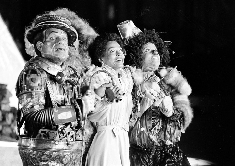 Photo - FILE - In this Oct. 4, 1977 file photo, Diana Ross, center, as Dorothy, Michael Jackson, right, as Scarecrow, and Nipsey Russell as Tinman perform during filming of the musical