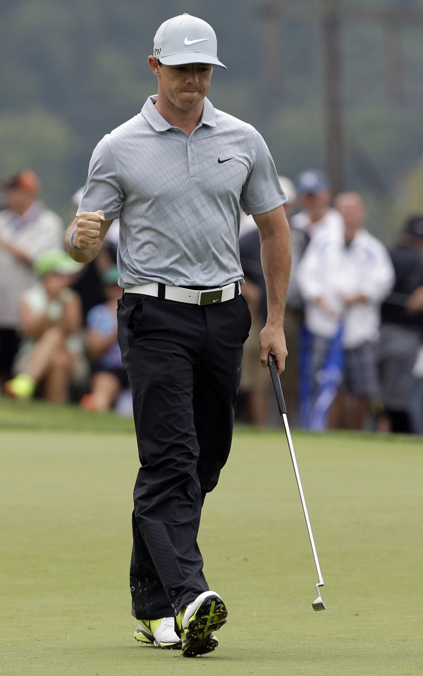 Photo - Rory McIlroy, of Northern Ireland, reacts after making a birdie on the ninth hole during the second round of the PGA Championship golf tournament at Valhalla Golf Club on Friday, Aug. 8, 2014, in Louisville, Ky. (AP Photo/John Locher)