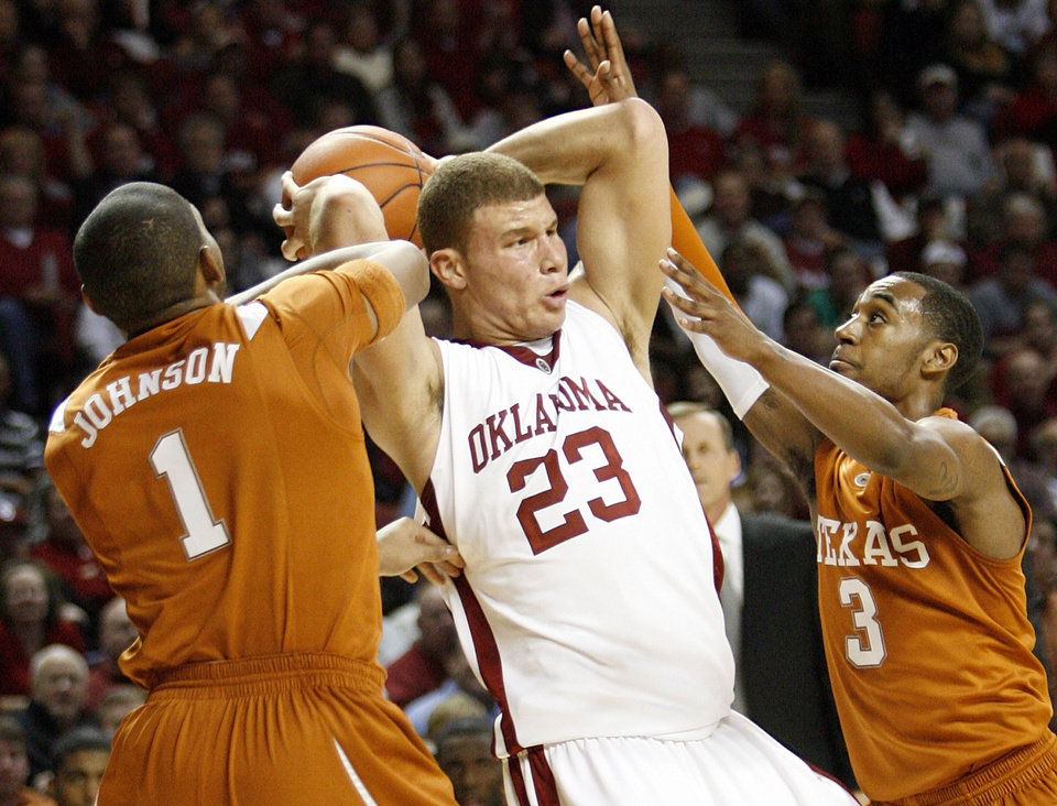 Photo - OU's Blake Griffin (23) tries to get past the defense of UT's Gary Johnson (1) and A.J. Abrams (3) in the first half during the Big 12 men's college basketball game between the University of Oklahoma and Texas at the Lloyd Noble Center in Norman, Okla., Monday, January 12, 2009. Photo By Nate Billings, The Oklahoman ORG XMIT: KOD