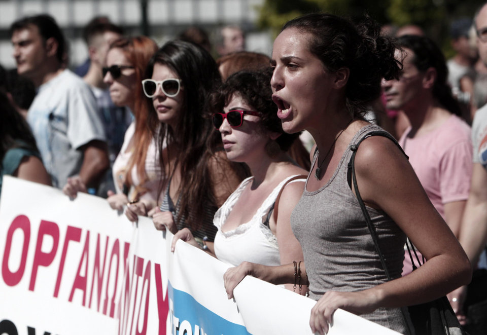 Photo -   Protesters of the Greek Communist party affiliated unions march in front of the Greek Parliament in Athens Wednesday Sept. 26, 2012. Greek workers walked off the job Wednesday for the first general strike since the country's coalition government was formed in June, as the prime minister and finance minister hammered out a package of euros 11.5 billion ($14.87 billion) in spending cuts. Athens has struggled to come up with more punishing austerity measures that would be acceptable to its rescue creditors, with disagreements arising between the three parties that make up the coalition government. Greece's creditors have demanded more fiscal reforms if they are to continue handing out rescue loans preventing the country from a messy default that could roil the euro. (AP Photo/Nikolas Giakoumidis)