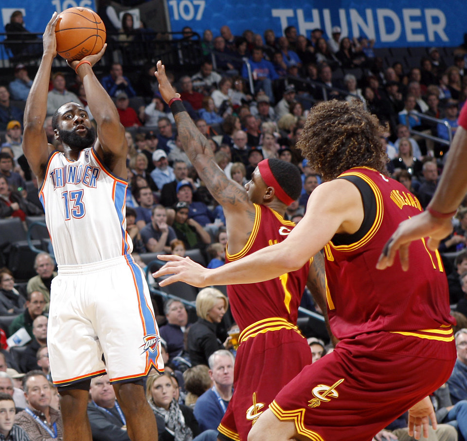 Photo - Oklahoma City's James Harden shoots over Cleveland's defense during the first half of their NBA basketball game at the OKC Arena in Oklahoma City on Sunday, Dec. 12, 2010.  The Thunder beat the Cavaliers106-77. Photo by John Clanton, The Oklahoman