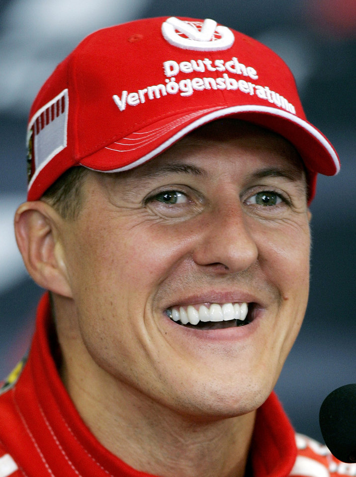 Photo - FILE - The Aug. 6, 2006 file photo shows retired Ferrari Formula One driver Michael Schumacher in Istanbul, Turkey.   Schumacher's manager says the Formula One great is no longer in a coma and has left a French hospital where he had been receiving treatment since a skiing accident in December. Manager Sabine Kehm says in a statement Monday, June 16, 2014, that Schumacher has left the hospital in Grenoble