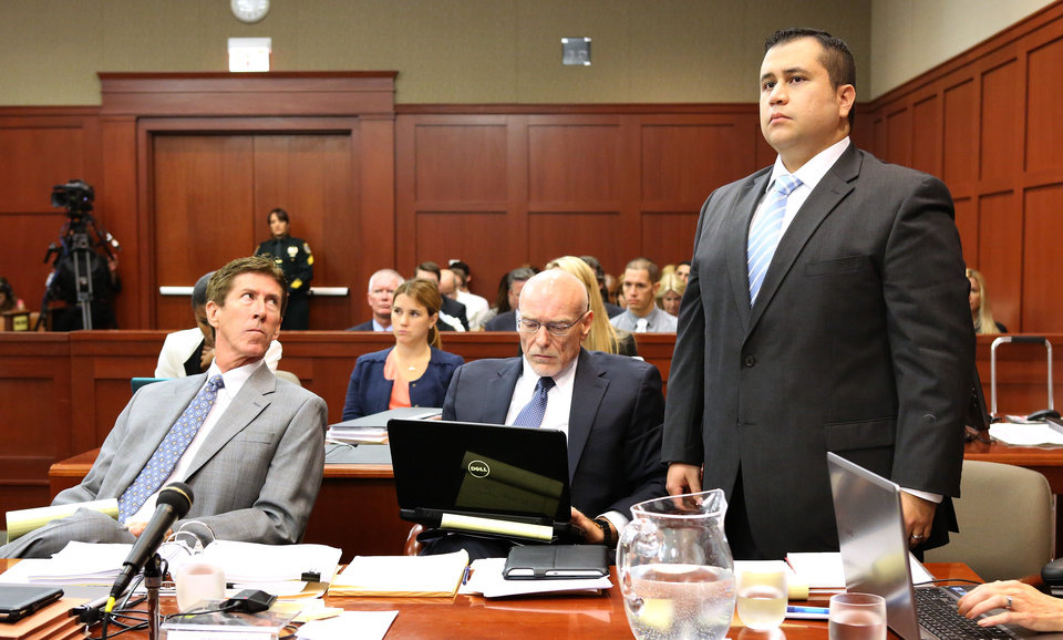 George Zimmerman, right, stands up at the defense table with his attorneys, Mark O\'Mara, left, and Don West, center, as he is identified by state witness Doris Singleton, a Sanford police officer, during her testimony in Zimmerman\'s trial in Seminole circuit court, in Sanford, Fla., Monday, July 1, 2013. Zimmerman has been charged with second-degree murder for the 2012 shooting death of Trayvon Martin.(AP Photo/Orlando Sentinel, Joe Burbank, Pool)