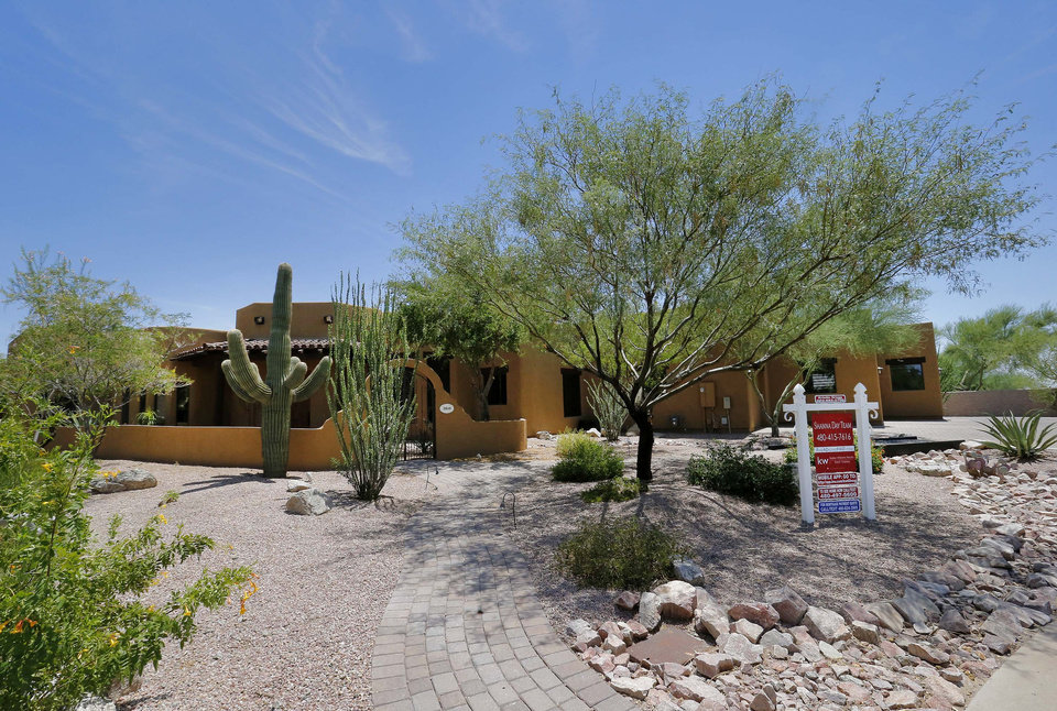 Photo - A luxury home with a listing price of $1 million is shown on Wednesday, July 30, 2014, in the Las Sendas community of Mesa, Ariz. The more than 4,000-square-foot home has a desert view on a golf course in the Phoenix suburb as well as a four car garage. (AP Photo/Matt York)
