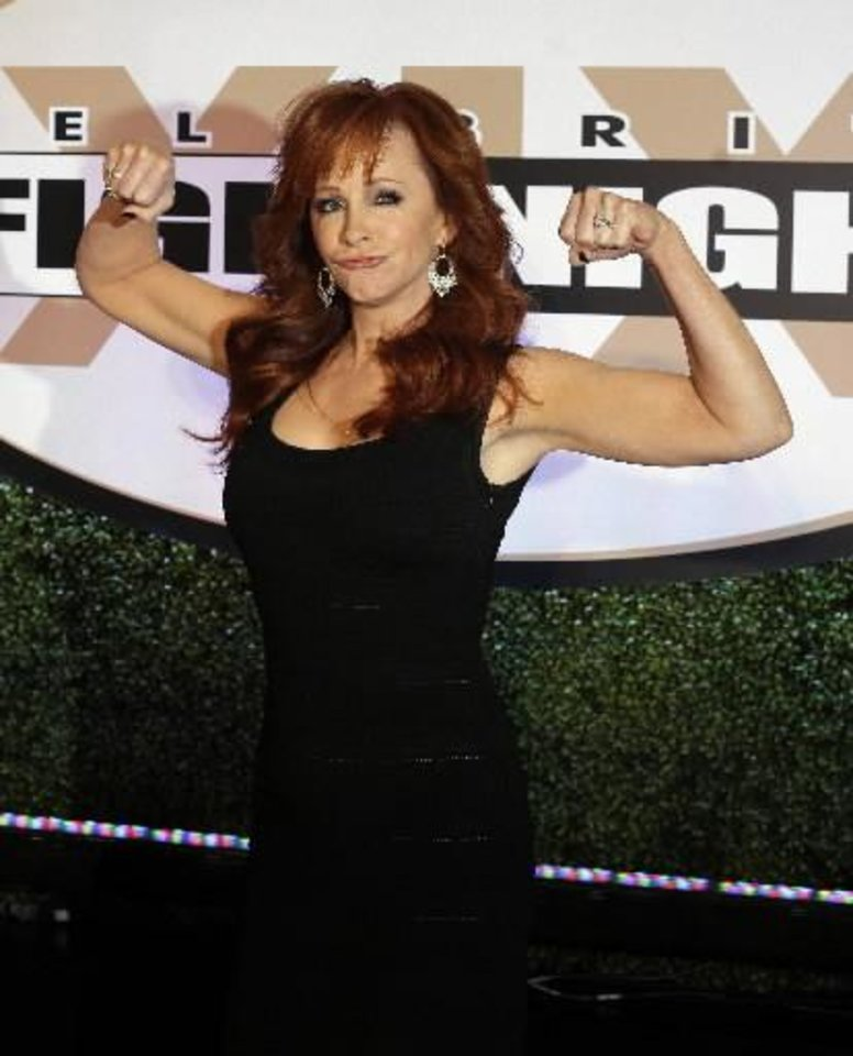 Emcee Reba McEntire arrives at Muhammad Ali\'s Celebrity Fight Night XIX at the JW Marriott Desert Ridge Resort and Spa, Saturday, March 23, 2013, in Phoenix. (AP)