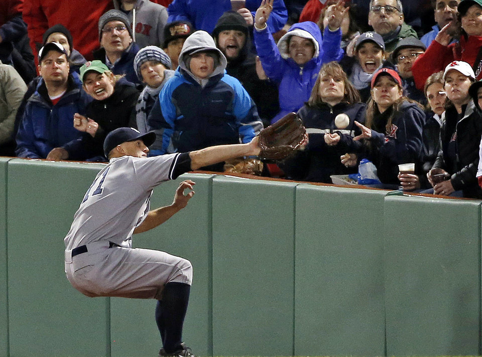 Photo - New York Yankees right fielder Brett Gardner cannot make the catch on a ground-rule double by Boston Red Sox's Mike Napoli during the third inning of a baseball game at Fenway Park in Boston, Wednesday, April 23, 2014. Dustin Pedroia scored on the hit. (AP Photo/Elise Amendola)