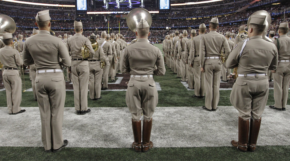 Photo - Members of the Texas A&M band prepare to take the field during the college football Cotton Bowl game between the University of Oklahoma Sooners (OU) and Texas A&M University Aggies (TXAM) at Cowboy's Stadium on Friday Jan. 4, 2013, in Arlington, Tx. Photo by Chris Landsberger, The Oklahoman