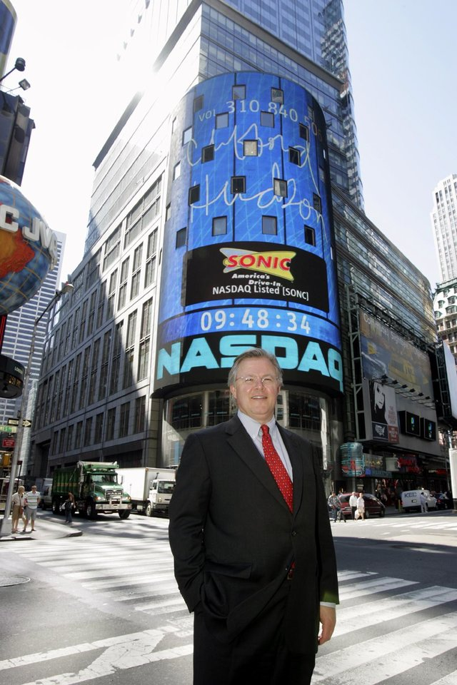 Photo -  Sonic CEO Cliff Hudson stands outside the Nasdaq Marketplace in New York City in 2005.
