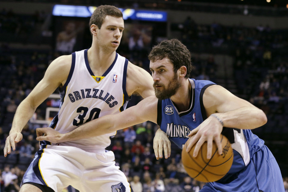 Memphis Grizzlies' Jon Leuer (30) defends against Minnesota Timberwolves' Kevin Love, right, in the first half of an NBA basketball game in Memphis, Tenn., Sunday, Dec. 15, 2013. (AP Photo/Danny Johnston)