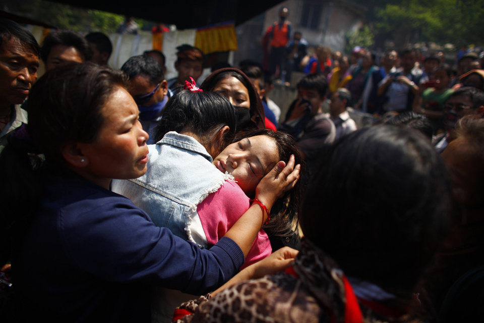 Daughter of Nepalese mountaineer Ang Kaji Sherpa, killed in an avalanche on Mount Everest, cries during the funeral ceremony in Katmandu, Nepal, Monday, April 21, 2014. Buddhist monks cremated the remains of Sherpa guides who were buried in the deadliest avalanche ever recorded on Mount Everest, a disaster that has prompted calls for a climbing boycott by Nepal's ethnic Sherpa community. The avalanche killed at least 13 Sherpas. Three other Sherpas remain missing and are presumed dead. (AP Photo/Niranjan Shrestha)