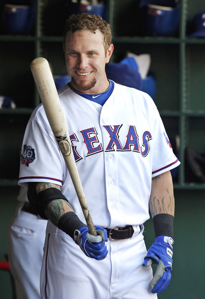 FILE - In this June 3, 2012, file photo, Texas Rangers\' Josh Hamilton stands in the dugout during the first inning of a baseball game against the Oakland Athletics in Arlington, Texas. Rangers general manager Jon Daniels said Thursday, Dec. 13, 2012, that Hamilton has agreed to a contract with the Los Angeles Angels. (AP Photo/Tim Sharp, File)