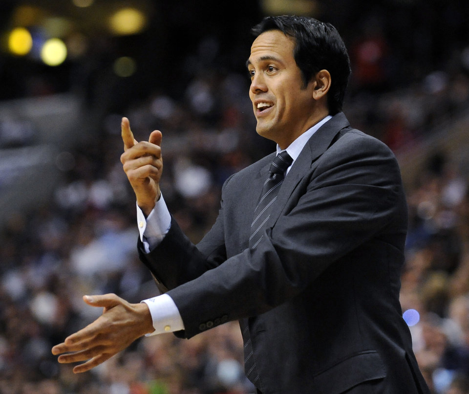 Miami Heat coach Erik Spoelstra signals to his team during the first half of an NBA basketball game against the Philadelphia 76ers, Saturday, Feb. 23, 2013, in Philadelphia. The Heat won, 114-90. (AP Photo/Michael Perez)