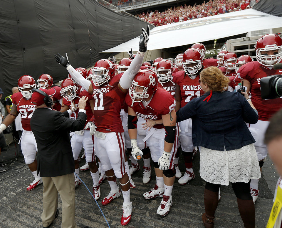 Photo - The Oklahoma team gets ready to take the field before the Red River Rivalry college football game between the University of Oklahoma (OU) and the University of Texas (UT) at the Cotton Bowl in Dallas, Saturday, Oct. 13, 2012. Oklahoma won 63-21. Photo by Bryan Terry, The Oklahoman