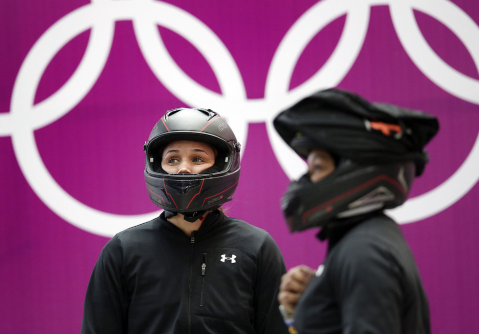 Photo - Breakman Lolo Jones, left, and pilot Jazmine Fenlator of the United States prepare for a training session for the women's bobsleigh at the 2014 Winter Olympics,  Sunday, Feb. 16, 2014, in Krasnaya Polyana, Russia. (AP Photo/Michael Sohn)