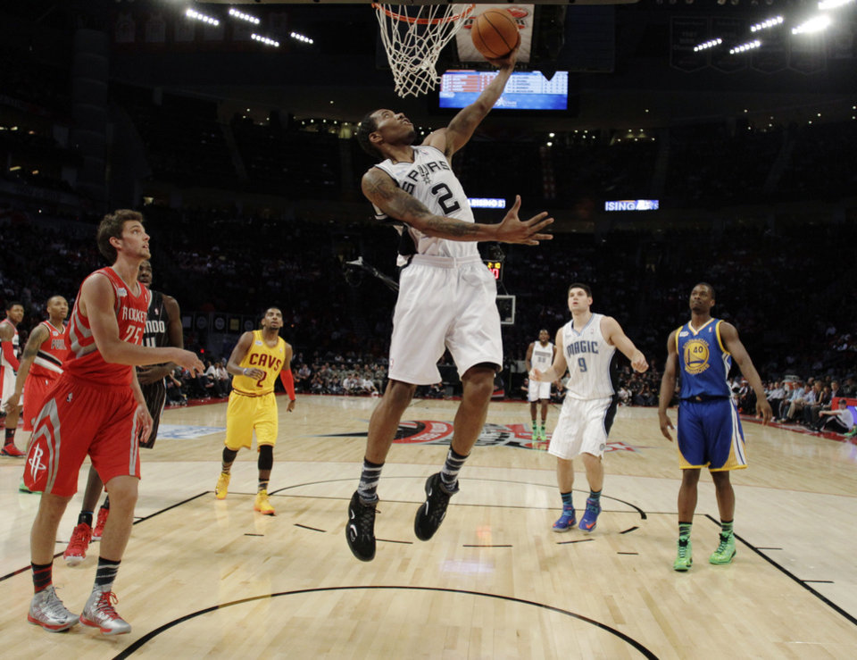 Team Chuck's Kawhi Leonard of the San Antonio Spurs shoots against Team Shaqduring the first half of the Rising Stars Challenge basketball game at NBA All-Star Weekend, Friday, Feb. 15, 2013, in Houston. (AP Photo/Eric Gay)