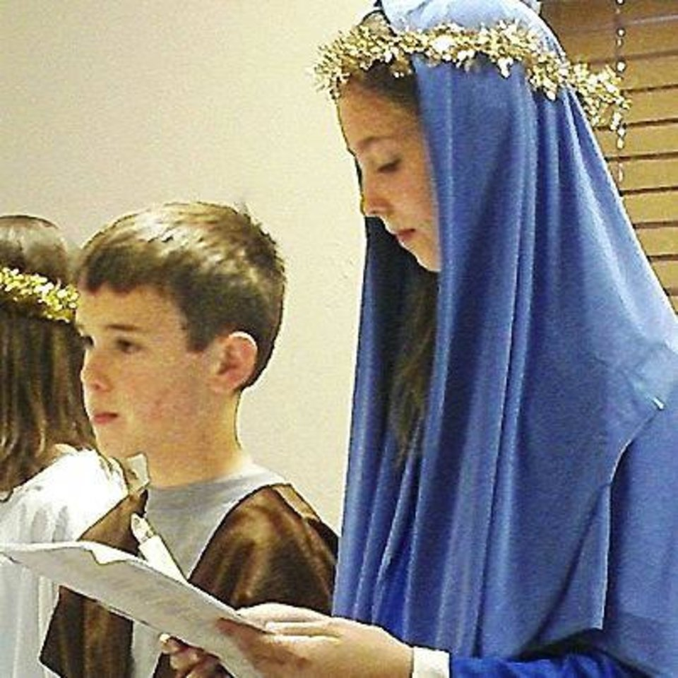 Joseph, portrayed by David Turner, and Mary, portrayed by Kalli Launhardt, seek shelter after traveling to Bethlehem during the recent Las Posadas event at St. Mary's Episcopal Church in Edmond. Photo provided    <strong></strong>